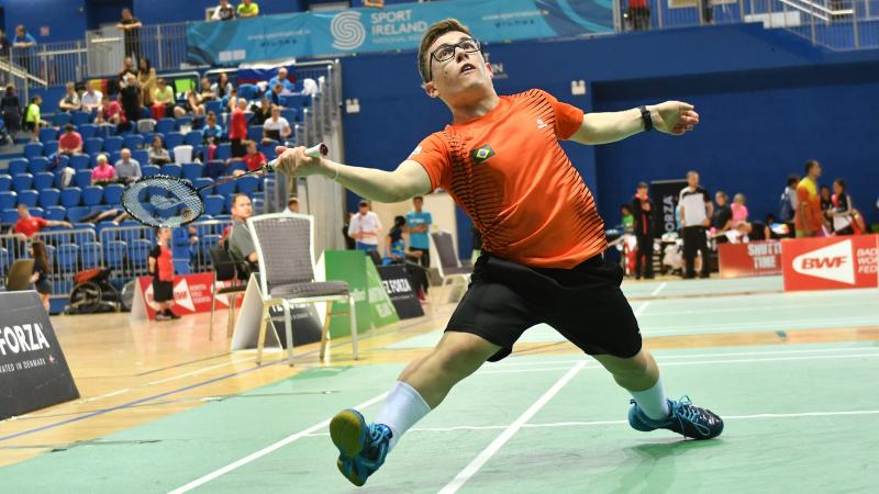 male Para badminton player Vitor Goncalves Tavares plays a forehand