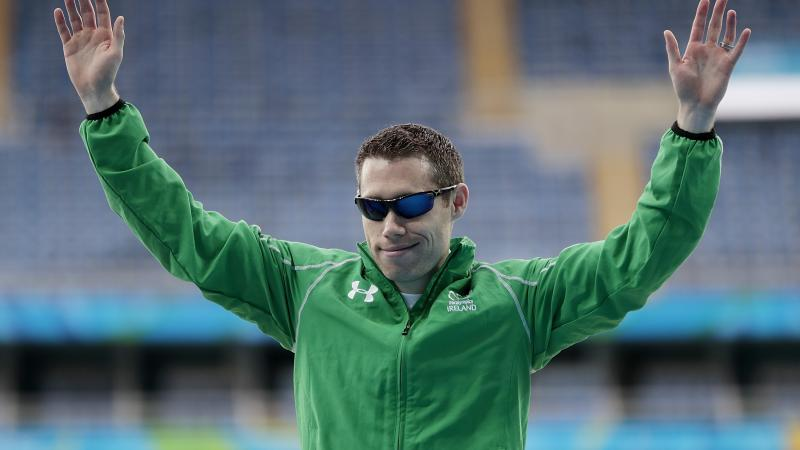 Para athlete Jason Smyth raises his arms