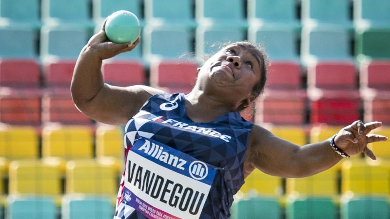 female Para athlete Rose Vandegou prepares to throw the shot put