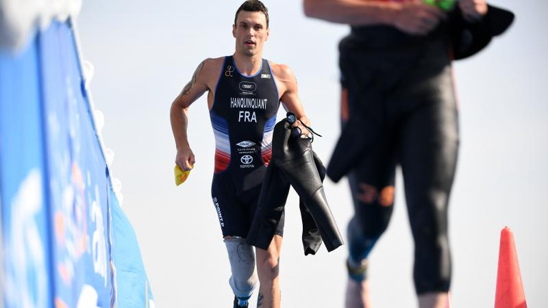 male Para triathle Alexis Hanquinquant sprints towards the finish line