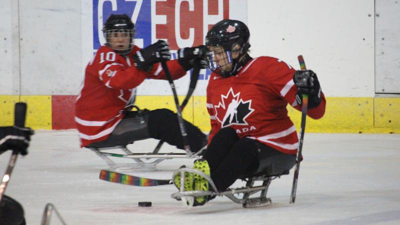 two female Canadian Para ice hockey players on the ice