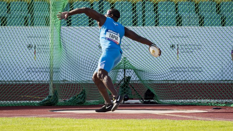 male Para athlete Oney Tapia prepares to throw a discus