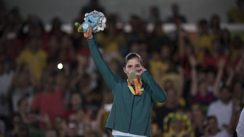 Woman kisses her medal