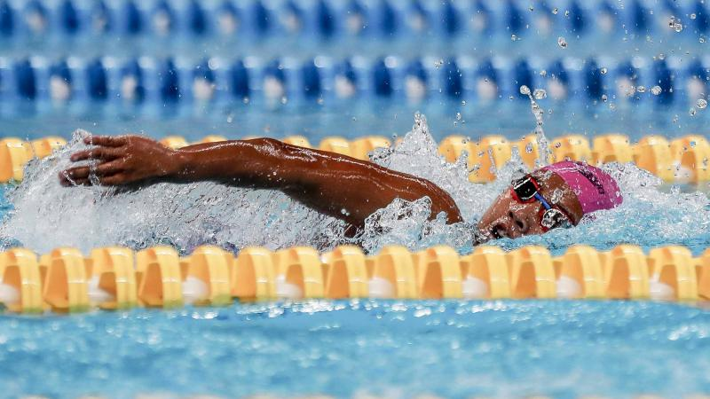female Para swimmer Indriani Syuci in the pool completing a freestyle stroke