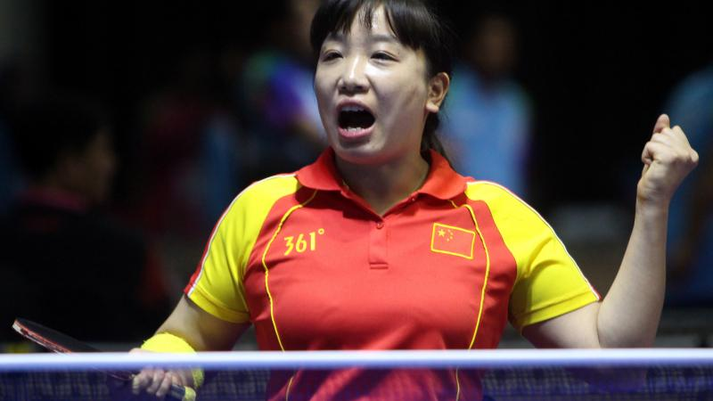 female Para table tennis player Xue Juan clenches her fist and shouts in celebration