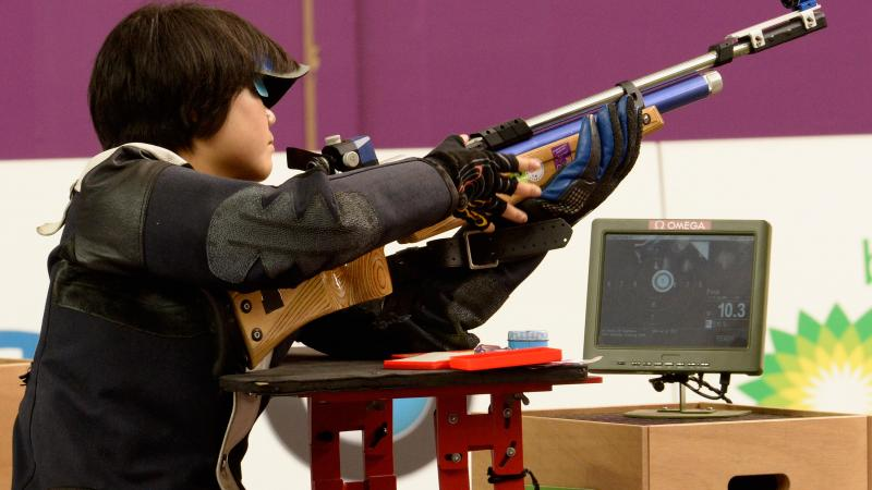 female Para shooter Cuiping Zhang looks at her target screen