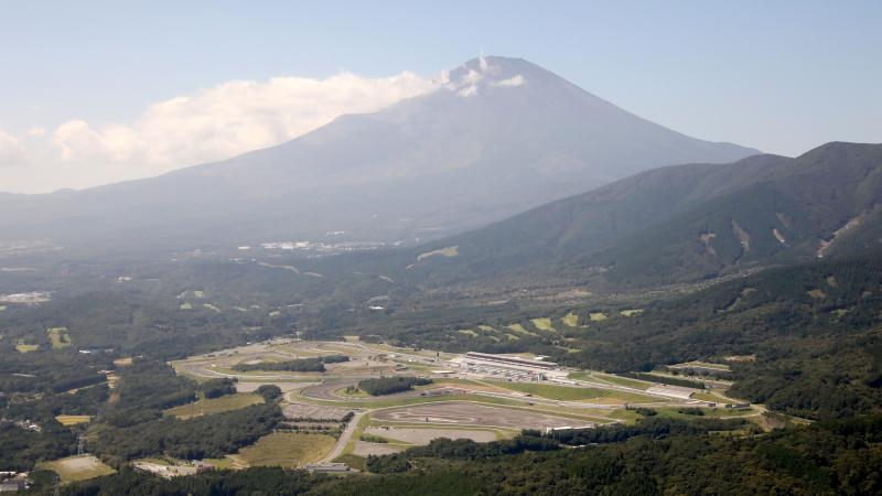 Motor racing circuit with a mountain in the background