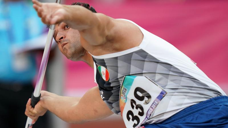 male Para athlete Amanolah Papi prepares to throw a javelin