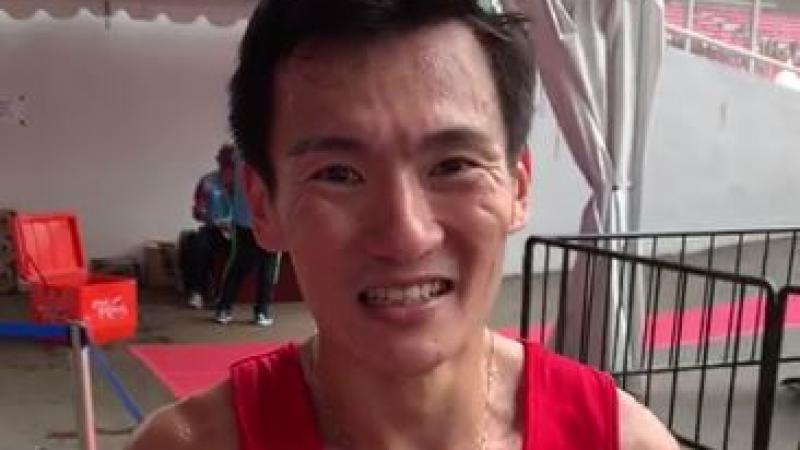 male Para athlete Zac Leow Zi Xiang smiles at the camera