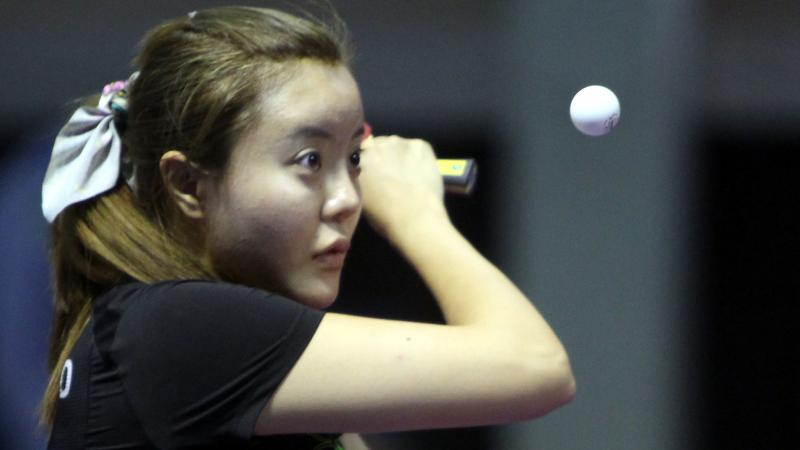 female Para table tennis player Mao Jingdian plays a backhand