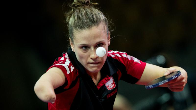 Natalia Partyka competing at the Para Table Tennis World Championships, holding the bat and watching the ball closely