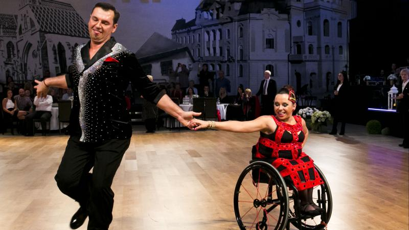 female Para dancer Helena Kasicka holding hands with her male partner during a dance