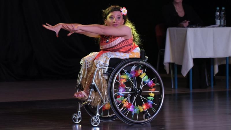 female Para dancer Julia Sadkowska stretches out her arms during a dance move