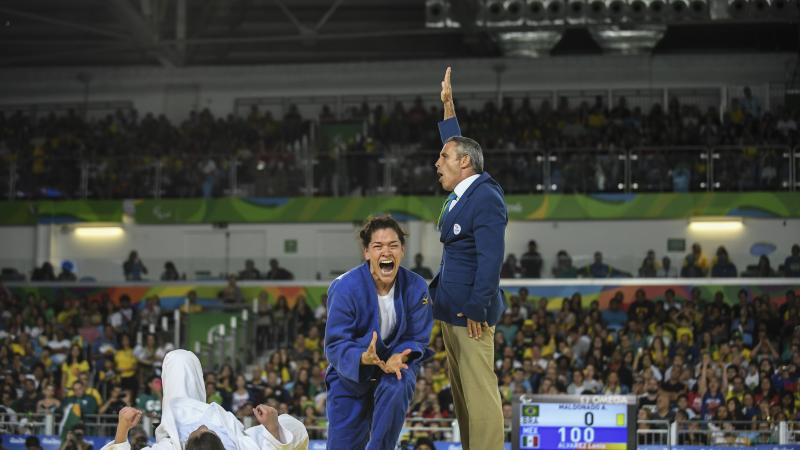 female judoka Lenia Ruvalcaba getting up off her knees and screaming in joy