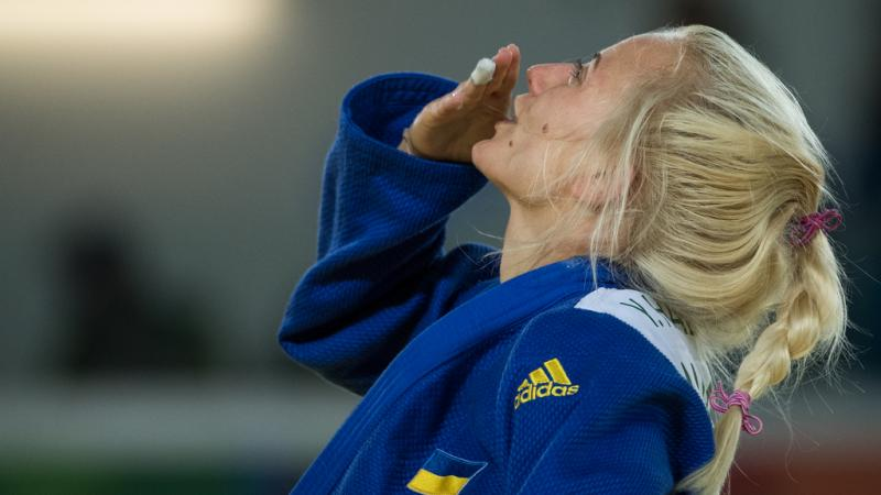 female judoka Yuliya Halinska blows a kiss to the sky