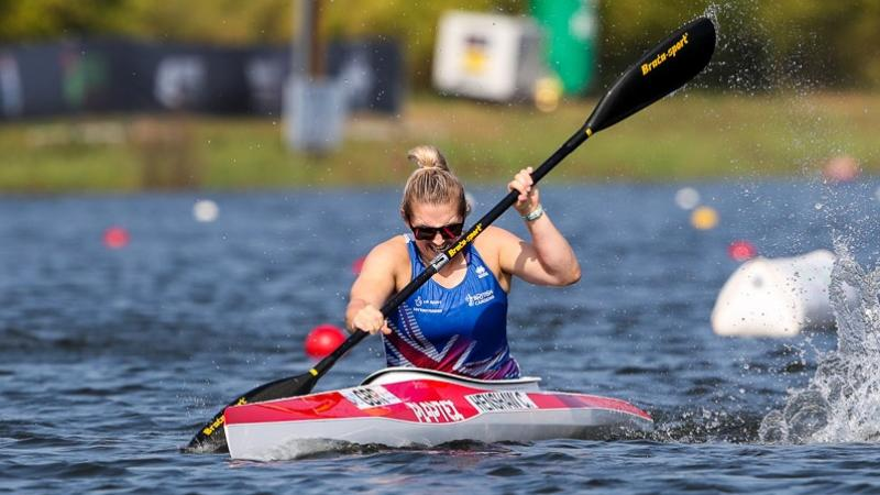 female Para canoeist Charlotte Henshaw makes a stroke through the water