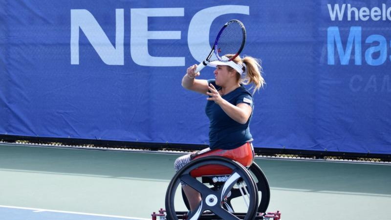 female wheelchair tennis player Giulia Capocci plays a forehand on a hard court