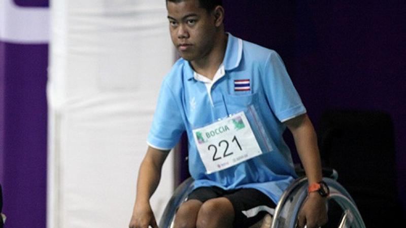 male boccia player Boontep Pachdee in a wheelchair