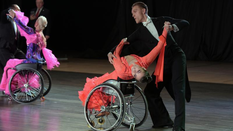Para dancers Hanna Harchakova and Roman Usmanov in a ballroom pose on the dance floor