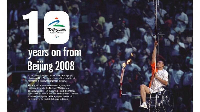 Page of a magazine showing a man in wheelchair climbing a rope with the Paralympic couldron
