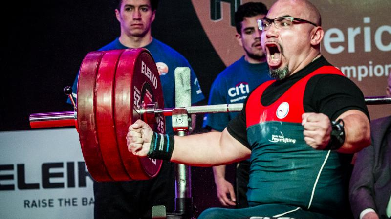 Chile's Juan Carlos Garrido celebrates winning gold at the Bogota 2018 orld Para Powerlifting Americas Open Championships.