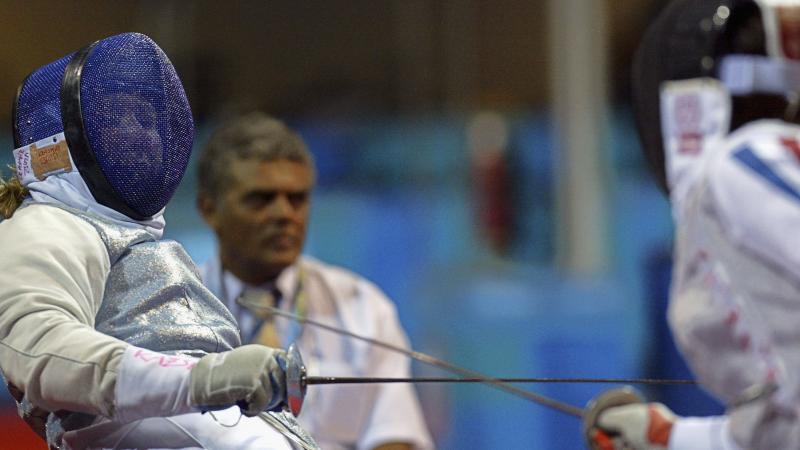 female wheelchair fencer Zsuzsanna Krajnyak dodges away from the foil