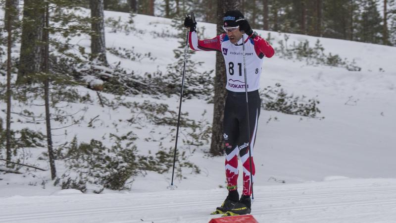 male Para Nordic skier Brian McKeever stands on skis