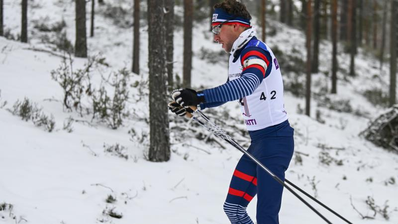 male Para Nordic skier Benjamin Daviet pushes through the snow