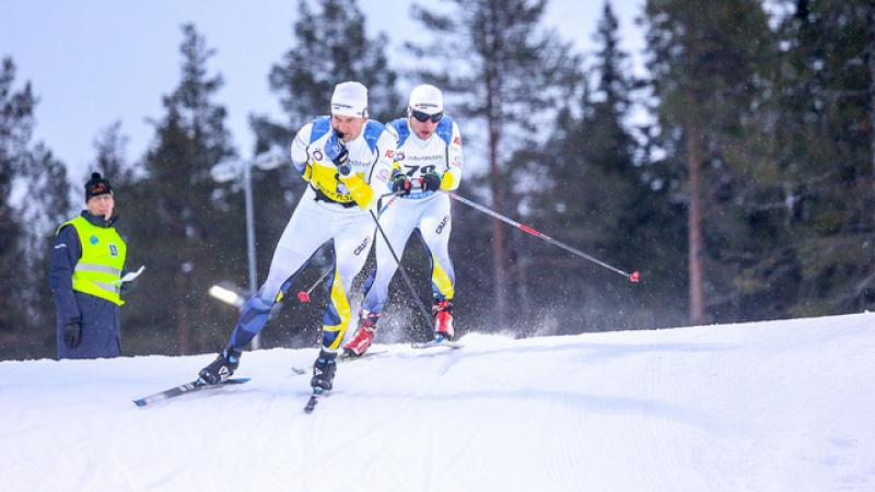 Swedish vision impaired skier follows behind his guide