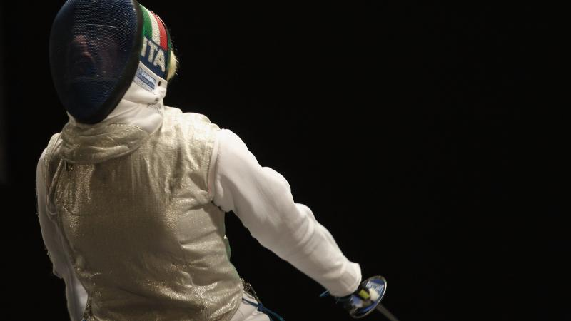 female wheelchair fencer Beatrice Vio screams through her helmet after winning a point
