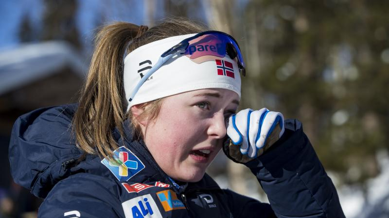 female Para Nordic skier Vilde Nilsen wipes away a tear
