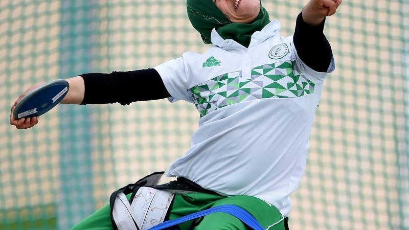Female Para athlete Mounia Gasmi throws a discus