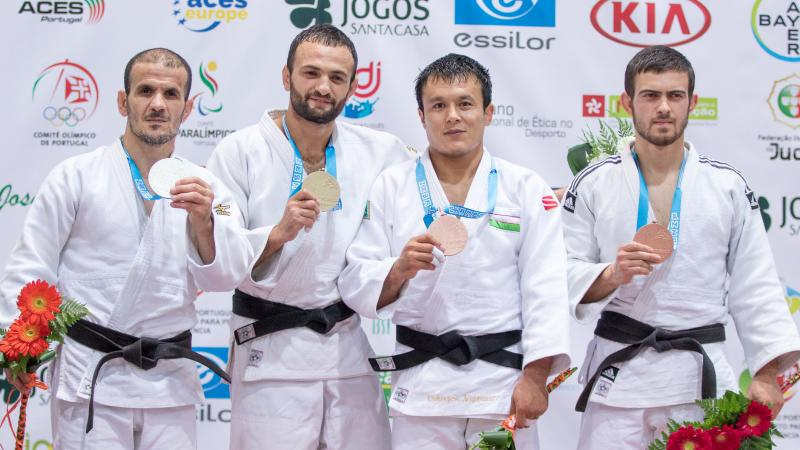 four male judokas on the podium with their medals, with Giorgi Gamjashvili on the end holding bronze
