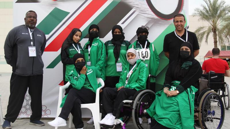 a group of female Saudi Arabian Para athletes and their two male coaches