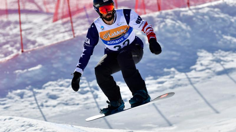 A male Para snowboarder competing