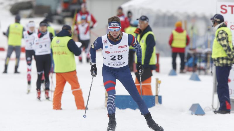 male Para Nordic skier Benjamin Daviet skis towards the finish line