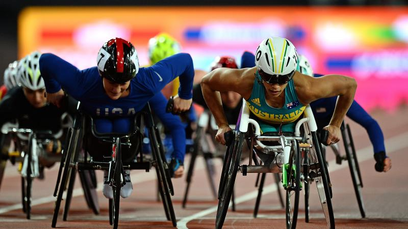female wheelchair racers going head to head around the track