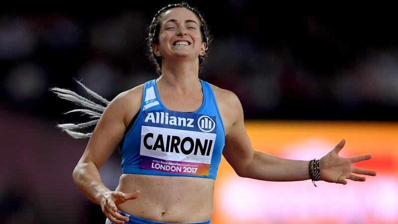 female Para sprinter Martina Caironi celebrates as she crosses the finish line