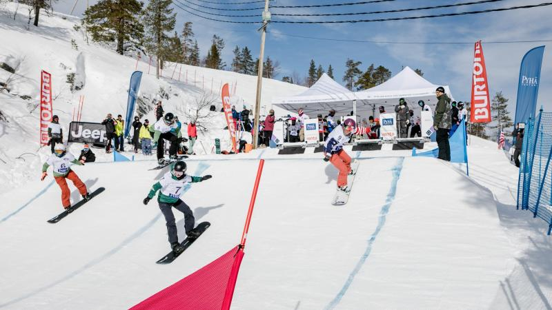 Lisa Bunschoten (bib No. 7) leads the way in the first ever women's four-by-four snowboard-cross race