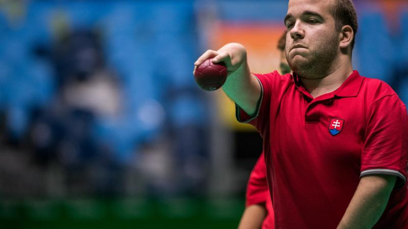 male boccia player Samuel Andrejcik throws a ball