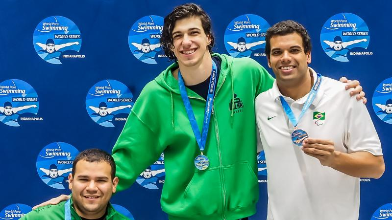 Simone Barlaam, in the middle, set a new world record in the men's 50m freestyle S9