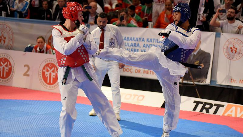 male Para taekwondo fighter Juan Diego Garcia Lopez kicks another fighter in the chest