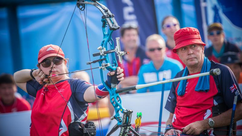 female Para archer Jessica Stretton prepares to shoot an arrow