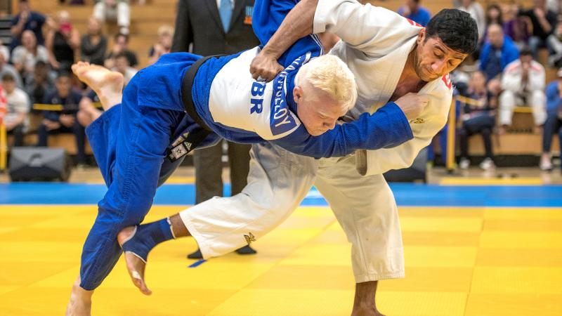 male judoka Ramil Gasimov wrestles another judoka to the ground