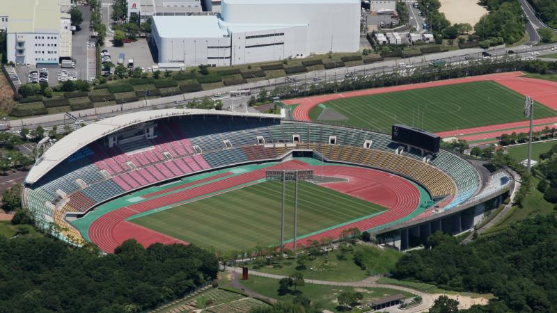 An aerial view of a stadium with an athletics track