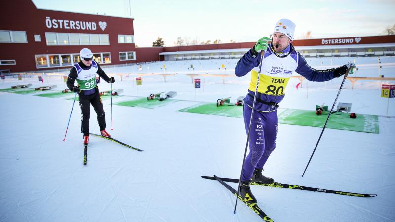 A blind Nordic skier following his guide