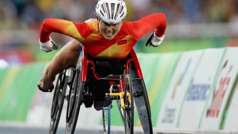 female wheelchair racer Hongzhuan Zhou on the track