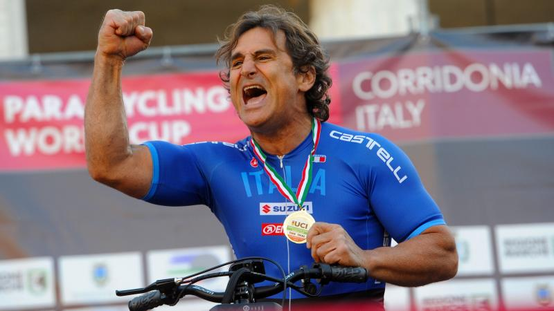 Italian cyclist Alex Zanardi celebrates