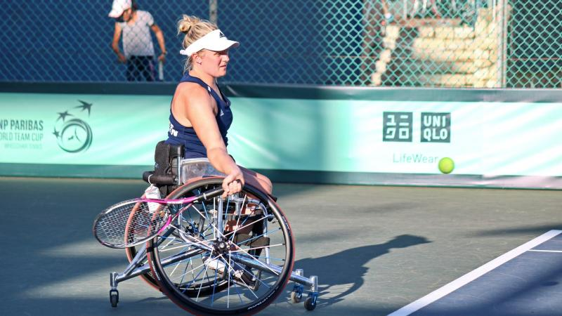 Wheelchair tennis player Jordanne Whiley about to hit the ball