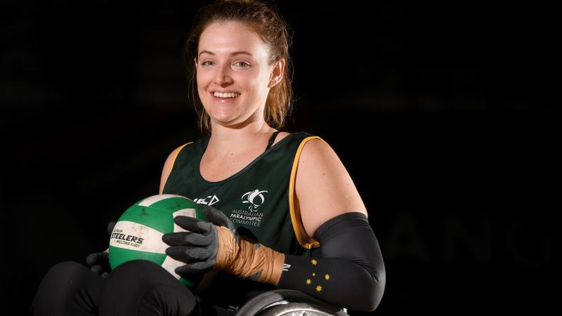 female wheelchair rugby player Shae Graham holding a ball